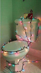 Elf on the shelf decorates the toilet