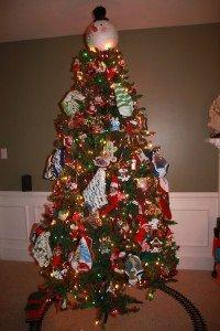 Elf on the shelf hides on the Christmas tree