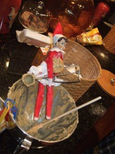Elf on the shelf makes Christmas cookies