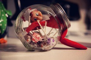Elf on the shelf stuck in candy jar